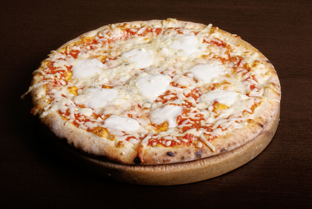 formagi: Fresh  baked quatro formagi pizza with parmesan, blue cheese, mozzarela and gorgonzola