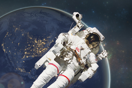 spacesuit: Planet Earth with an Astronaut. Elements of this image furnished by NASA
