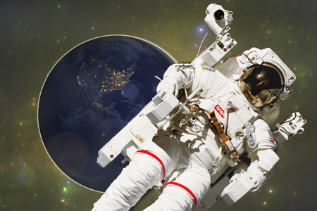 Astronaut with the planet Earth. Elements of this image furnished by NASA Stock Photo