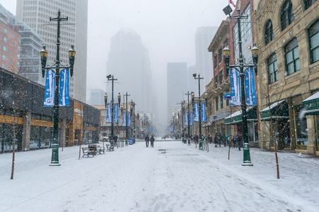 CALGARY, Canada - March 15. 2018: Heavy snow storm at 8 ave in city downtown