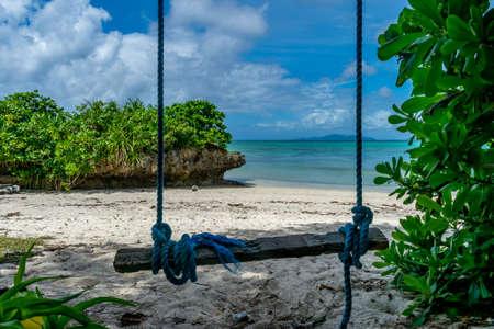 Rustic swing at the beautiful tropical beach, Ishigaki Island, Okinawa, Japan