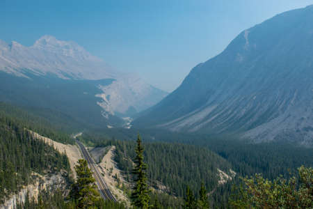 Columbian icefield parkway in between Banff and Jasper with smoke from wildfires