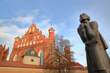 mickiewicz: VILNIUS, LITHUANIA: St Annes Church and Bernardine Church with Adam Mickiewicz statue on the right hand side