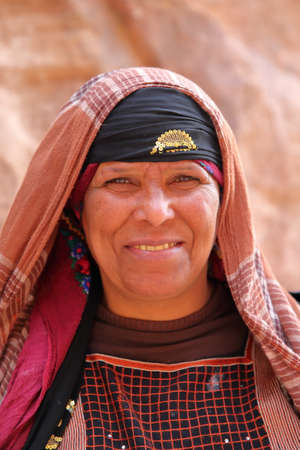 PETRA, JORDAN, MARCH 12, 2016: Portrait of a bedouin woman nicely dressed Editorial