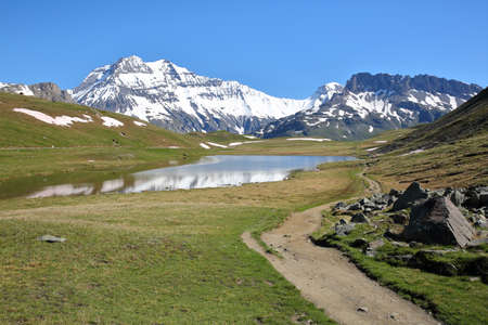 brune: VANOISE, FRANCE: View of three summits (Grande Casse, Grande Motte and Pierre Brune) from a lake in Northern Alps