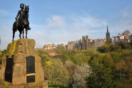 greys: EDINBURGH, SCOTLAND-MAY 8, 2016: The Royal Scots Greys Monument at Princes Street Gardens with spring colors Editorial