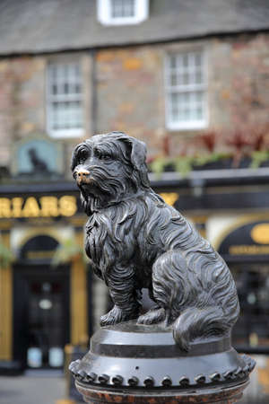 EDINBURGH, SCOTLAND-MAY 6, 2016:Statue of Greyfriars Bobby with a pub in the background