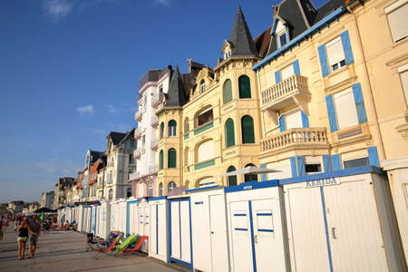 pas: WIMEREUX, FRANCE - AUGUST 27, 2016: Beach huts and traditional houses at sunset in Cote dOpale, Pas-de-Calais Editorial