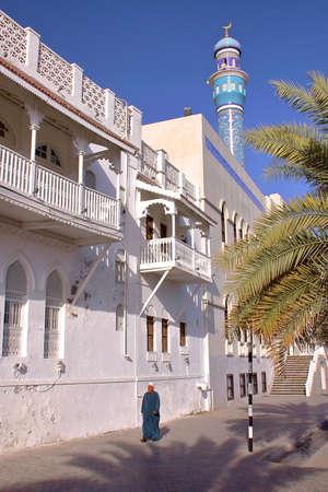 MUSCAT, OMAN - FEBRUARY 10, 2012: An Omani man walking along Sur Al Lewatia Mosque in Muttrah