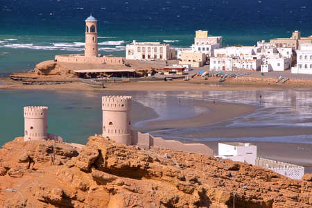 SUR, OMAN: View of Ayjah with watch towers in the foreground Stock fotó