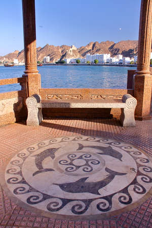 muttrah: MUSCAT, OMAN: The sidewalk decorated with dolphins in Muttrah Stock Photo