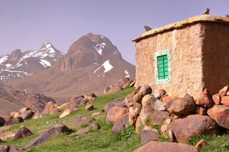 MOROCCO: Sheepfold close to Sirwa peak in the Atlas mountains with Berber architecture Stock Photo