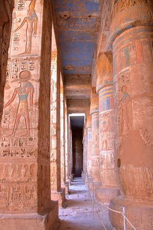 LUXOR, EGYPT: Hieroglyphs and columns at Medinet Habu temple Stock Photo - 77578594
