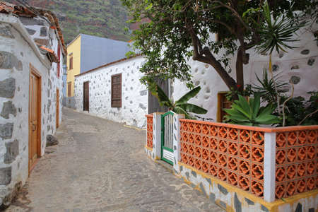 AGULO, LA GOMERA, SPAIN: Cobbled street with traditional houses Stock Photo