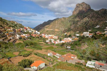 VALLEHERMOSO, LA GOMERA, SPAIN: General view of the valley with terraced fields and Roque Cano in the background
