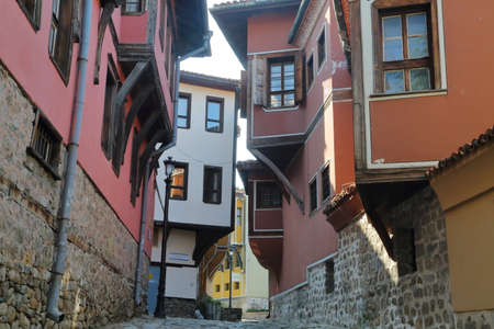 PLOVDIV, BULGARIA - AUGUST 1, 2015: A narrow street with colorful traditional houses in the old town of Plovdiv Editorial