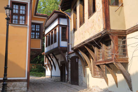 PLOVDIV, BULGARIA: A narrow street with colorful traditional houses in the old town of Plovdiv Stock Photo
