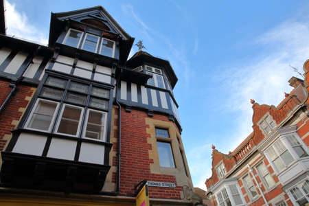 winchester: WINCHESTER, UK - FEBRUARY 4, 2017: Exterior facades in the commercial St Thomas Street and High Street Editorial