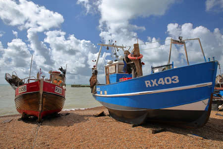 HASTINGS, UK - JULY 22, 2017: Beach launched colorful fishing boats with a beautiful sky Editorial