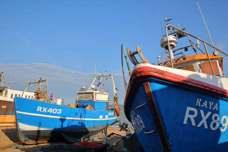 HASTINGS, UK - JULY 21, 2017: Beach launched fishing boats at sunset