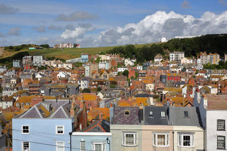 View of the roofs of Hastings old town from East Hill with West Hill in the background and beautiful clouds, Hastings, UK Stock Photo