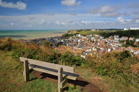 General view of Hastings old town from East Hill with a wooden bench in the foreground, Hastings, UK Stock Photo