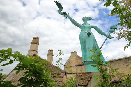 Bradford on Avon, UK - AUGUST 13, 2017: Millennium Statue with stone roofs in the background Editorial
