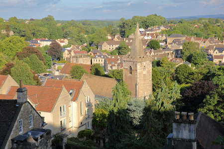 View of the town from Tory neighborhood with the bell tower of Holy Trinity Church in Bradford on Avon, UK Фото со стока
