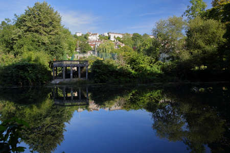 Reflections on river Avon towards Tory neighborhood in Bradford on Avon, UK Stock Photo