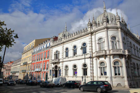 LISBON, PORTUGAL - NOVEMBER 4, 2017: Colorful facades at Principe Real square in Bairro Alto neighborhood with  The Embaixada LX indoor fashion market on the right side