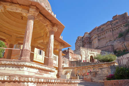 JODHPUR, RAJASTHAN, INDIA - DECEMBER 17, 2017: The exterior facade of Mehrangarh fort with a Chhatri in the foreground Sajtókép