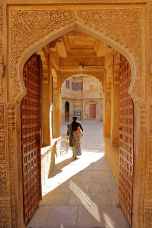 JAISALMER, RAJASTHAN, INDIA - DECEMBER 20, 2017: An entrance door in Jawahir Vilas inside Mandir Palace Editorial