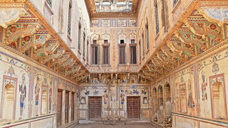 MANDAWA, RAJASTHAN, INDIA - DECEMBER 27, 2017: Chokani Double Haveli with details of the frescoes and mural paintings