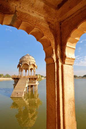 View of a chhatri (through arches) at Gadi Sagar lake, Jaisalmer, Rajasthan, India