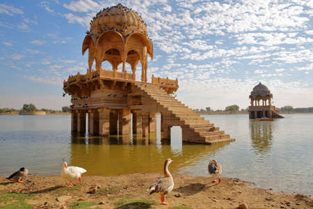 View of chhatris at Gadi Sagar lake with geese in the foreground, Jaisalmer, Rajasthan, India Stock fotó - 94510177