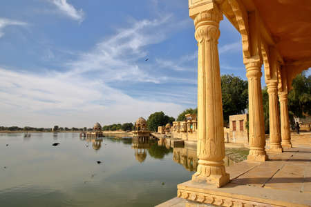 View of chhatris (through arches and columns) at Gadi Sagar lake, Jaisalmer, Rajasthan, India