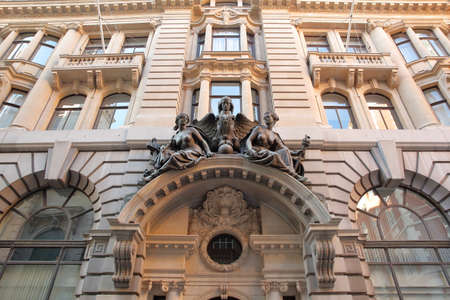 LONDON, UK – FEBRUARY 25, 2018: Facade of a building on Lombard Street in the financial district of the City of London with sculptures and carvings 에디토리얼