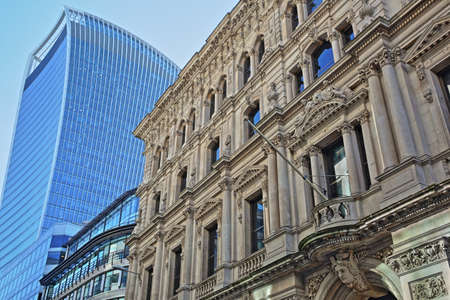LONDON, UK – FEBRUARY 25, 2018:  Facade of a building on Lombard Street in the financial district of the City of London with 20 Fenchurch Street (Walkie Talkie) in the background 에디토리얼