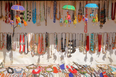 Close-up on colorful souvenirs on sale in a shop inside the Site of Petra, Jordan, Middle East