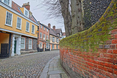 Elm Hill cobbled street with medieval houses from the Tudor period in Norwich, Norfolk, UK Stock Photo