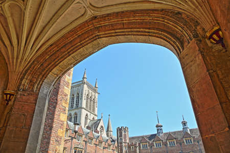 CAMBRIDGE, UK - MAY 6, 2018: St Johns College University, the Second Court viewed through an arch, with St Johns college Chapel in the background