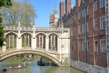 CAMBRIDGE, UK - MAY 6, 2018: The Bridge of Sighs at St Johns College University with tourists and students punting on the river Cam
