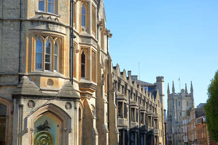 CAMBRIDGE, UK - MAY 6, 2018: Facades on Trumpington Street with the Corpus Clock (designed by John Taylor) in the foreground and the Pitt Building in the background