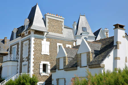 SAINT MALO, FRANCE - AUGUST 28, 2018: Traditional house facades in Parame along Hoguette beach, viewed from the esplanade (digue de rochebonne)