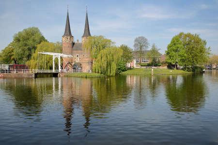 The Eastern Gate (Oostpoort), reflected on Schiekanaal in Delft, Netherlands