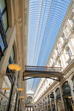 THE HAGUE, NETHERLANDS - APRIL 19, 2019: De Passage, an indoor shopping arcade (built between 1882 and 1885), with a view on a high glass ceiling