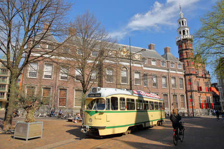 THE HAGUE, NETHERLANDS - APRIL 18, 2019: A tramway located at Rond de Grote Kerk Square with Oude Stadhuis (Old Town Hall, 16 century) in the background