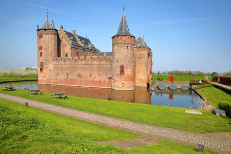 MUIDEN, NETHERLANDS - APRIL 7, 2019: Reflections of Muiderslot Castle, a medieval castle near Amsterdam