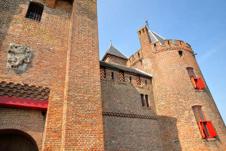 MUIDEN, NETHERLANDS - APRIL 7, 2019: Close-up on Muiderslot Castle, a medieval castle near Amsterdam