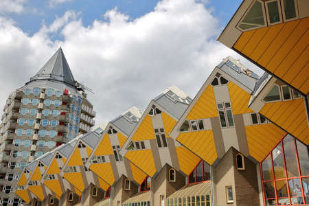 ROTTERDAM, NETHERLANDS - MAY 31, 2019: Cube houses (Kijk Kubus), architectural unusual angular cube shape apartment block, located near Oudehaven Harbor, with the Pencil building (Het Potlood) in the background Sajtókép
